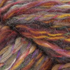 Berroco Mojo is a colorful wool, acrylic, nylon  mohair blend in a super bulky weight.