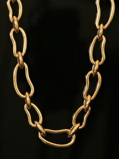 Pomellato 18k Yellow Gold Large Open Bean Link Necklace. Available at London Jewelers.