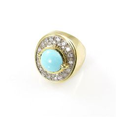 An 18 karat yellow gold, turquoise and diamond ring, circa 1980- Camilla Dietz Bergeron