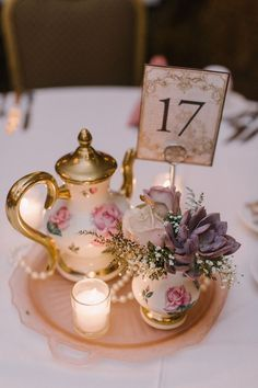 Vintage Wisconsin Hotel Wedding Vintage-inspired wedding centerpiece idea – votives, pearls, vintage tea pot and teacups holding ivory rose, succulent + baby's breath flower arrangements {Karen Ann Photography} Tea Party Wedding, Tea Party Bridal Shower, Hotel Wedding, Wedding Table, Wedding Ideas, Hotel Reception, Trendy Wedding, Wedding Simple, Reception Ideas