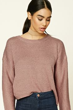 Style Deals - A ribbed knit sweater featuring a boxy silhouette, a round neckline, and long dropped sleeves.