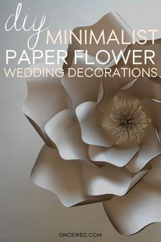 Make your wedding look a million dollars without breaking bank with these DIY minimalist paper flower wedding decorations! Follow our step-by-step DIY wedding tutorial here.  #diyweddingtutorial #diyweddingdecorations #minimalistweddingdecorations #weddingpaperflower