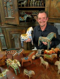 Staffan Haegermark collector of Swedish Dala horses. The horses in the picture are from the 19th and the 20th century.