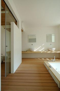 Like wooden sink counter and sunken tub... wooden floor is interesting  ;-)