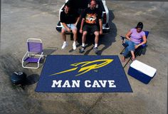"""University of Toledo Man Cave UltiMat Rug 5x8 - Decorate your home, office, or tailgate with 5'x8' area rugs by SPORTS LICENSING SOLUTIONS. Made in U.S.A. 100% nylon carpet and non-skid recycled vinyl backing. Officially licensed and chromojet printed in true team colors.FANMATS Series: MCaveULTIMATTeam Series: University of ToledoProduct Dimensions: 59.5""""x94.5""""Shipping Dimensions: 32""""x20""""x4"""". Gifts > Licensed Gifts > Ncaa > All Colleges > University Of Toledo. Weight: 12.00"""