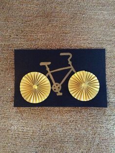 Gold and black bike card with fan wheels.