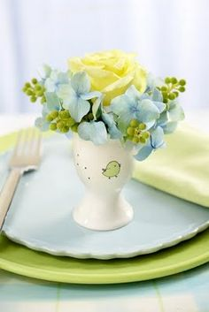 Color Inspiration--lime green, pale yellow, soft blue with a dash of white.  I would love this color scheme in my bedroom.  Love lime green, but really want some blue.  This way I can have both.