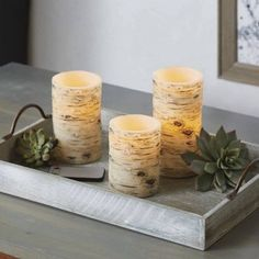 Try using LED pillar candles throughout your home. Place them inside lanterns for a modern twist on classic style or use them with wall sconces to create dramatic and functional accent pieces. Flameless Candles, Pillar Candles, City Living, Living Room, Christmas Wallpaper, Better Homes And Gardens, Candle Making, Accent Pieces, Wall Sconces