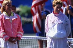 Monica Seles and Martina Navratilova during the Women's Singles Final trophy ceremony at the 1991 US Open in Louis Armstrong Stadium