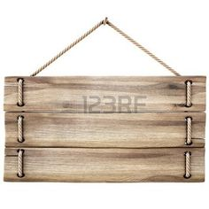 blank wooden sign hanging on a rope. isolated on white. photo