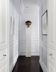 """Antique with Modern."" I really like the paneled walls, and there are all kinds of DIY tutorials to do it with crown moulding. I love it when designers mix classic paneled walls with modern design. :)"