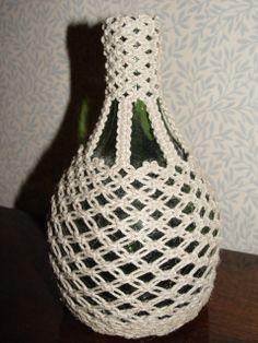 Pullon päälle punottu pellavalangasta suojus
