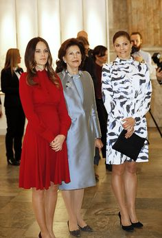 (L-R) Princess Sofia opted for a stylish deep Gucci red dress with pleated skirt detail and a pussybow collar while Queen Silvia looked regal in a dark grey taffeta dress with matching jacket and pearls.  Crown Princess Victoria coming closest in a vibrant blue and white long-sleeve dress by Whyred with black heels.