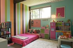 Small kid, BIG Color Room! Love the bold colors that bring so much personality to the room! The stripes are awesome.
