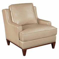 "A classic addition to your living room or library, this timeless arm chair features rich leather upholstery and a loose back pillow.  Product: ChairConstruction Material: Hardwood solids, walnut veneers and leatherColor: CreamDimensions: 33.5"" H x 32"" W x 38"" D"