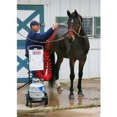 Portable hot water heater for bathing horses! I never knew this existed. I was hoping to find something that would not require a large stationary hot water heater and electricity. Runs on batteries and a portable propane tank. Genius level.