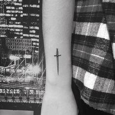 Micro sword tattoo