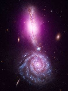 Fatal Attraction - VV 340, also known as Arp 302, provides a perfect example of galactic collision during the early stages of their interaction. The galaxy near the top of the image is VV 340 North, whose fatal attraction is bound to succumb galaxy at the bottom of the image is VV 340 South.