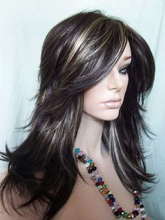 Nirvana Tarah Wig in dark brown highlighted with golden blonde. Super long bangs!