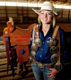 Avon teenager Addy Haviland poses with eight of the buckles along with the saddle she won competing at the Silver State International Rodeo in Winnemucca, Nevada last month. Along with the buckles and saddle, Haviland won a three-horse trailer for being the 2015 all-around cowgirl champion. (Portrait by John Zsiray)