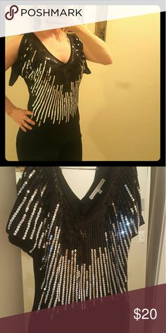 Sequin Party Blouse Sewn waterfall sequins with elastic bottom. 'V' front and 'V' back great with leggings and heels for a night out on the town! Almost Famous Tops Tunics