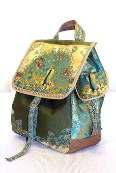 Peacock Backpack bag. Designed the pattern myself. Vinyl bottom, back and lined with vinyl to help keep the inside protected.
