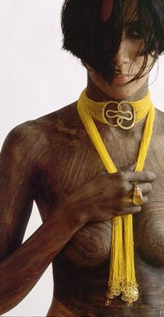 """Gurmit's """"Concubine"""" necklace inspired by the yoni symbol. 18 carat gold and glass beads."""