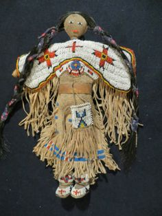 Beaded Doll, braintanned leather,sinew,old color beads