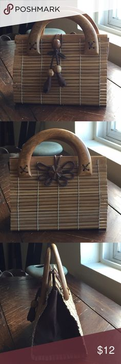 Wooden handbag Unique wooden handbag with cloth interior.  Never been carried.  Perfectly clean and in excellent condition.  I used it as a decoration and stored jewelry inside. Bags