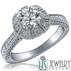This stunning diamond engagement ring features 14k white gold with 0.73 ct 100% natural round brilliant very good cut diamond center stone SI-1 clarity, F color surrounded by 0.90 ct round cut colorless side diamonds