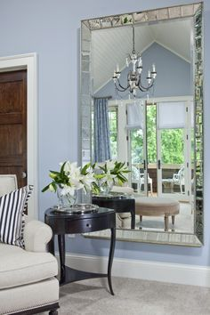 Large mirror on wall. A foot or so off the ground, to open up space. Would look Lovely!