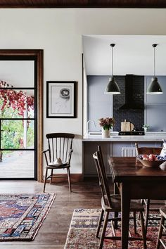 Love the mix of old and new. Floor boards are new!! Country Style May 17. Modern-homestead-kitchen-ACS0517p37