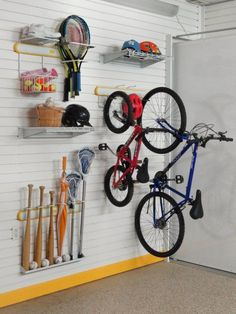 The Vertical Bike Racket Stick Racks Lifestyle Kit-Version III is a collection of three Sports Activity Racks a basket and three shelves. Garage Shelf, Diy Garage, Garage Storage, Garage Ideas, Storage Room, Vertical Bike Rack, Wall Mount Bike Rack, Diy Bike Rack, Garage Tool Organization