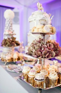 Pink and gold sweets fill an overflowing dessert table by Cake Opera Co., setting the mood for a whimsical afternoon.