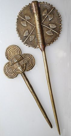 Africa | Hairpins.  The one on the left is from the Lobi people of Burkina Faso and it is bronze.  The one on the right is from the Ashanti people of Ghana. Again in Bronze | ©Eva Baby