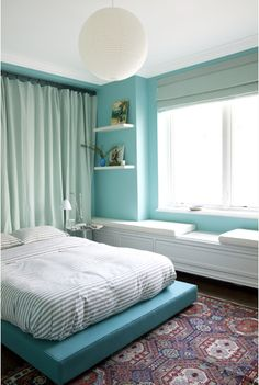Aqua walls with striped bedding to man it up.