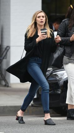 Elizabeth Olsen makes a coffee run look good as she shows off minimalist street style in cuffed jeans and a black top Elizabeth Chase Olsen, Elizabeth Olsen Scarlet Witch, Street Style Today, Godzilla, Olsen Sister, Minimalist Street Style, Elisabeth, Queen, Black Tops