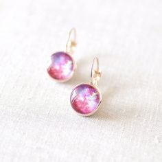 Juju Treasures Pink And Magenta Galaxy Earrings (525 THB) ❤ liked on Polyvore featuring jewelry, earrings, pink, earrings jewellery, pink earrings, galaxy jewelry, earring jewelry and cosmic jewelry
