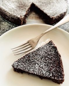 This delicious Swedish Gooey Chocolate Cake (kladdkaka) is a fudgy, rich, and incredibly easy dessert. It mixes up quickly in just one bowl! Perfect for #Choctoberfest.