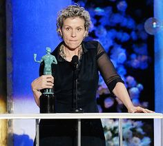 So that's why! Frances McDormand, who was unforgettably grim-faced at the Golden Globes earlier this month, won the 2015 SAG Award for Best Female Actress in a TV Movie or Miniseries and explained her sourpuss expression on Sunday, Jan. 25.