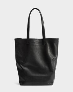 An all day, every day, every night carry all. Our simple tote in the softest leather, updated with a folded over top edge for added finish and durability. **** 15 in. H x 10 in. W x 5.25 in. D. Two ha