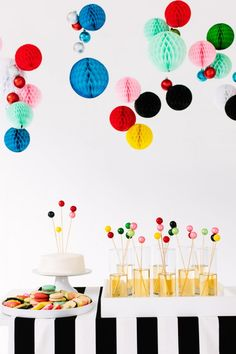20 creative ways to decorate your home and beyond with honeycomb paper pom poms, including pom pom mobiles, gift wrap inspiration and wedding decs. Party Decoration, Craft Party, Table Decorations, Ballon Party, Party Mottos, Honeycomb Paper, A Little Party, Colorful Party, Perfect Party