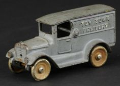 "KILGORE 'TOY TOWN' DELIVERY TRUCK.  Cast iron, painted in grey overall, embossed 'Toy Town Delivery' on sides of van, nickel disc wheels. 6"" l."