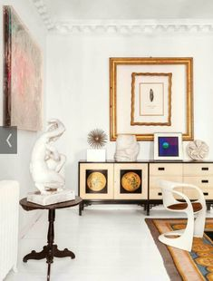 Eclectic and colourful in Madrid Vicky Cristina Barcelona, White Painted Floors, White Walls, Art Of Living, Living Room, Living Area, Exposed Brick Walls, Curved Sofa, Plank Walls