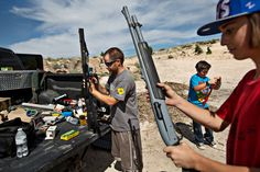 Dave Joseph, left, and his son, Casey, right, loaded guns for target shooting this month on land own... - Kim Raff for The New York Times