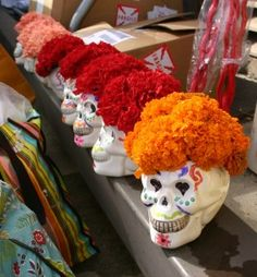 centerpiece idea- like this...only better.  skulls painted better w/ theme, flowers fresh and more interesting.