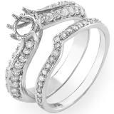 The row of round diamonds encircles the entire band of this elegant semi mount ring setting for her. Additional round diamonds flow along the 14K white gold band for added sparkle. Round diamonds grace the matching wedding band. The total diamond weight of this fine jewelry wedding set is 0.75 carats.