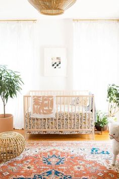 Grown-up décor sensibilities aren't off-limits for children's spaces. Incorporate design elements you already love—like rattan, Persian rugs, and geometric prints. #kidsbedroom
