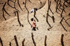 Jerome Delay—AP Feb. 15, 2013. Children walk on the Askia mausoleum, built in 1495 in Gao, northern Mali, one week after a suicide bomber o...