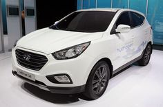 Lo and behold, folks: Hyundai has wowed the crowds in Paris with what it says is the world's first serial production hydrogen fuel cell vehicle. Honda may d Hyundai Suv, Fuel Cell Cars, Fuel Additives, 2015 Cars, Alternative Energy, Concept Cars, First World, Cool Cars, Volkswagen
